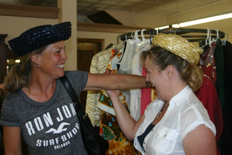 Juli and I trying on some fabulous hats in the antique store!