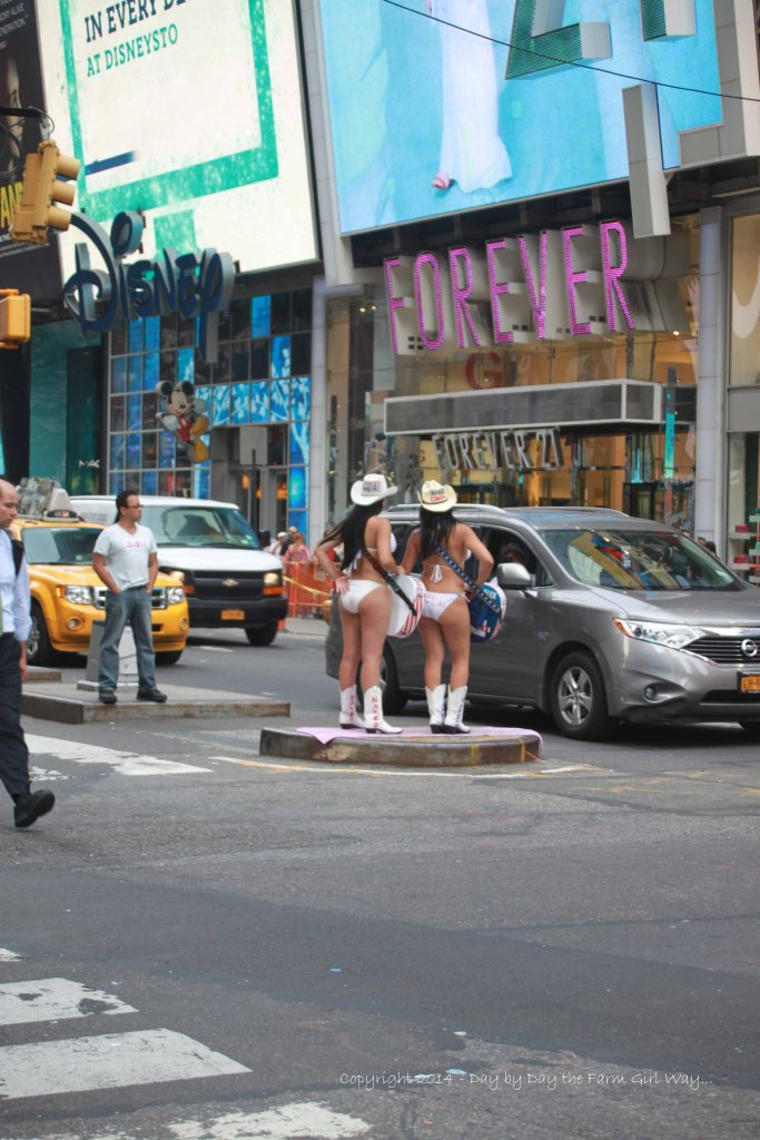 I guess theses two were giving the Naked Cowboy across the street a little competition. Our cowgirls in Oklahoma do not look like this!