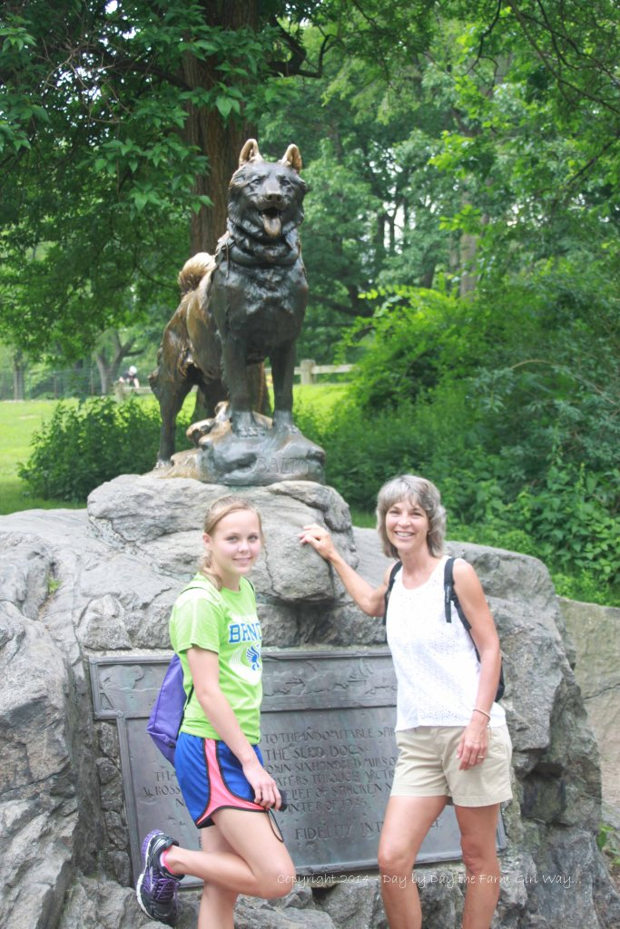 Em and I stand at the statue of Balto the sled dog in Central Park.