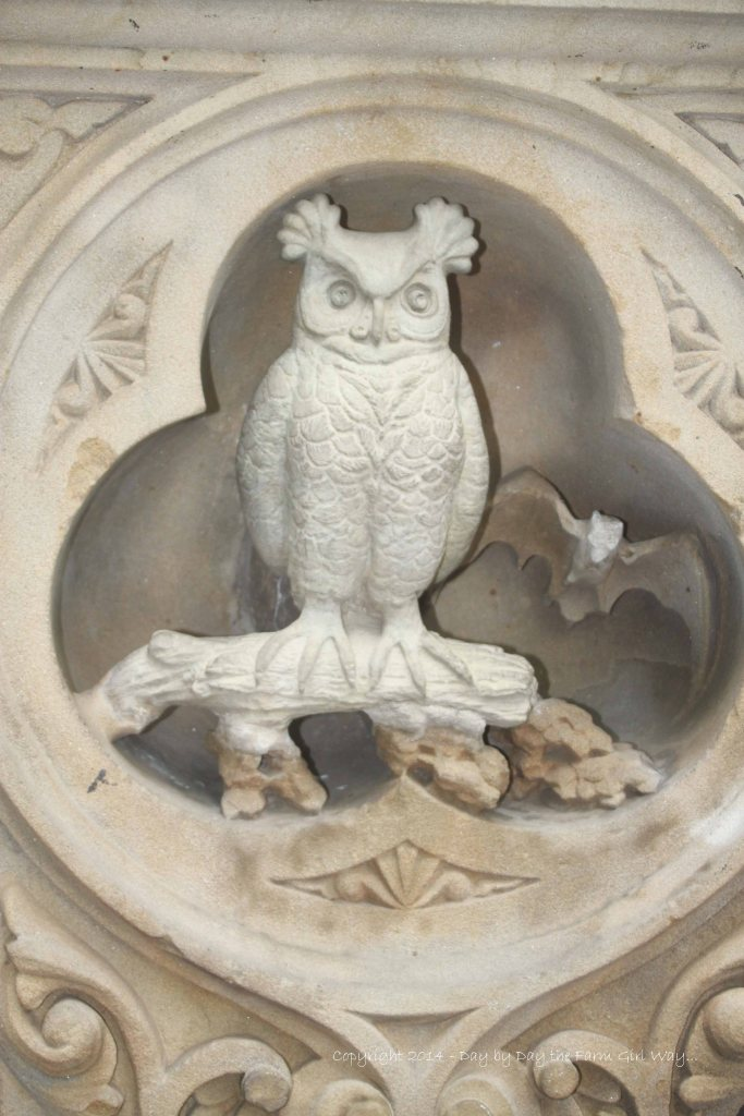 This stone owl and bat were part of a pillar in Central Park.