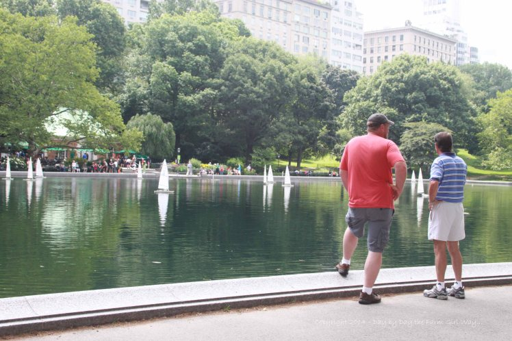FD and Chris take a moment to watch the model boats sailing on Conservatory Water in Central Park.