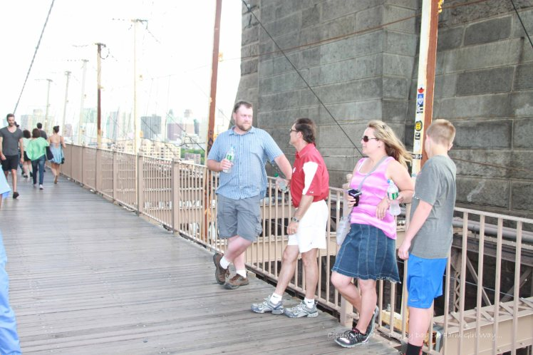 Chris, FD, Jules and Sid take a break at the halfway point to marvel at the view and construction of the Brooklyn Bridge.
