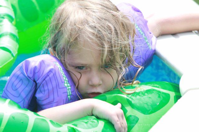 Jaci felt a little more comfortable with lots of floaties and a secure hold on the pool edge!