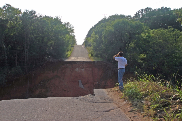 The dike of a large farm pond gave way during the August 2004 rains, obliterating roads further down.