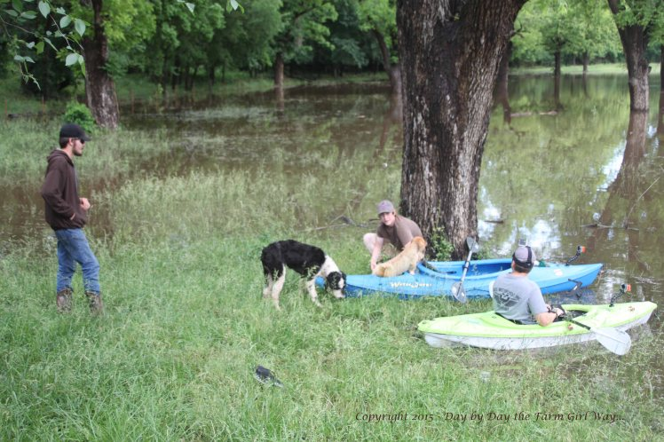 Our young neighbor and a couple of friends prepare to kayak in the quiet waters of the pecan orchard.