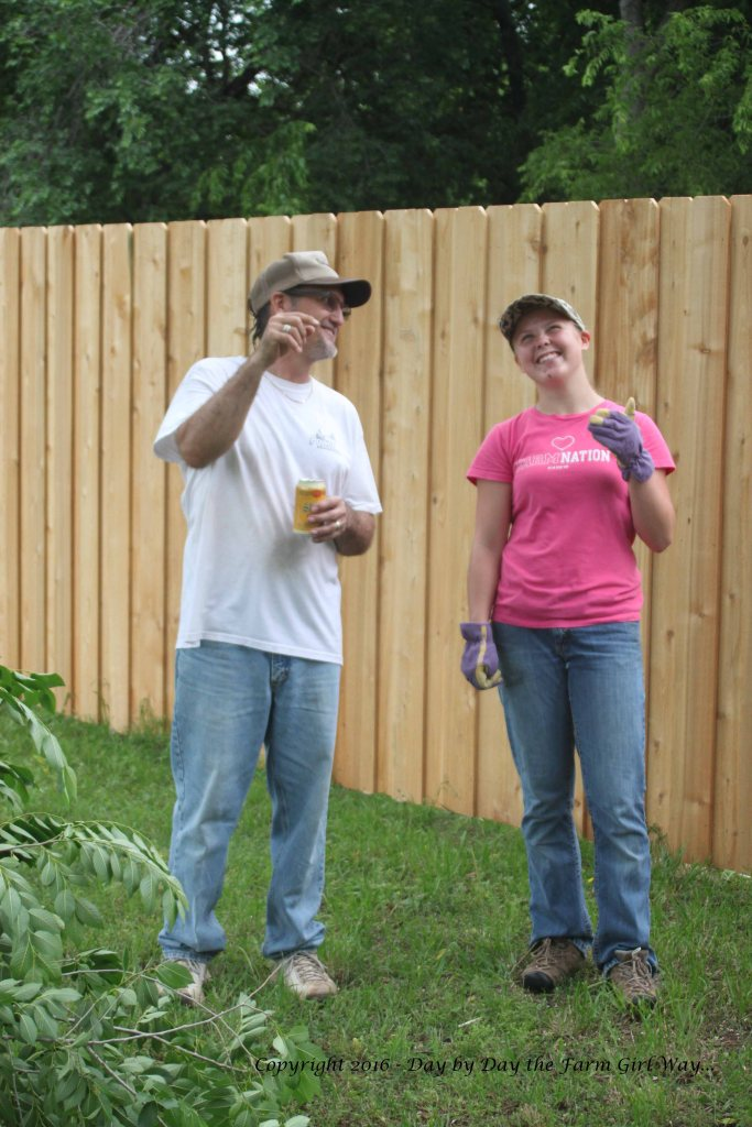 Forrest and Emily taking a break from tree trimming work.